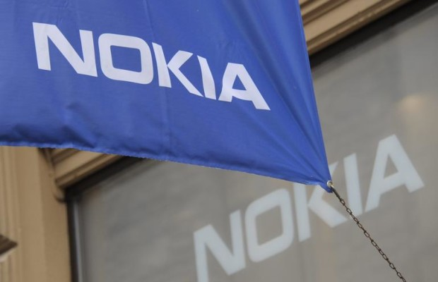 "A photo taken on September 7, 2012 shows a company flag outside the flagship store of Finnish mobile phone manufacturer Nokia in Helsinki. Nokia announced on September 3, 2013 the sale of its mobile phone unit to Microsoft for 5.44 billion euros (7.17 billion US dollars), bringing to an end its days as a phone maker. Nokia will grant the US software giant a 10-year non-exclusive licence to its patents and will itself focus on network infrastructure and services, which it called ""the best path forward for Nokia and its shareholders.""   AFP PHOTO / LEHTIKUVA / SARI GUSTAFSSON    - FINLAND OUT -        (Photo credit should read SARI GUSTAFSSON/AFP/Getty Images)"